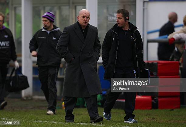 Wasps coach Shaun Edwards walks off at half time during the LV Anglo Welsh Cup match between Ospreys and London Wasps at Brewery Field on February 6...