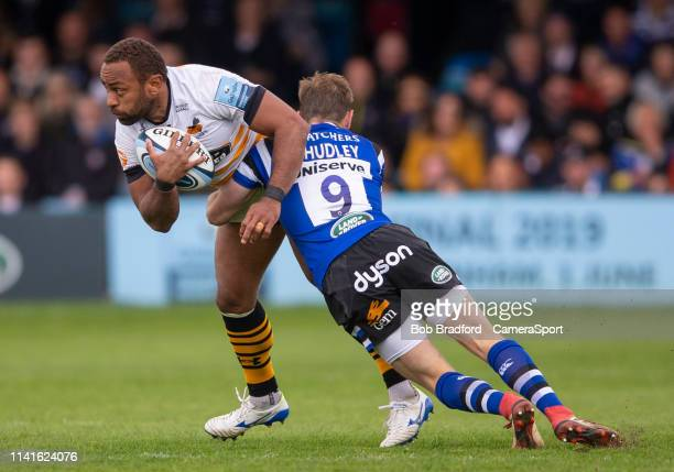 Wasps' Gaby Lovobalavu is tackled by Bath Rugby's Will Chudley during the Gallagher Premiership Rugby match between Bath Rugby and Wasps at...