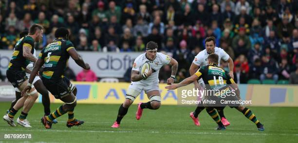 Wasps' Guy Thompson is tackled by Northampton Saints' Piers Francis during the Aviva Premiership match between Northampton Saints and Wasps at...