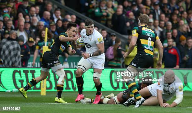 Wasps' Guy Thompson is tackled by Northampton Saints' Tom Collins and Jamie Gibson during the Aviva Premiership match between Northampton Saints and...