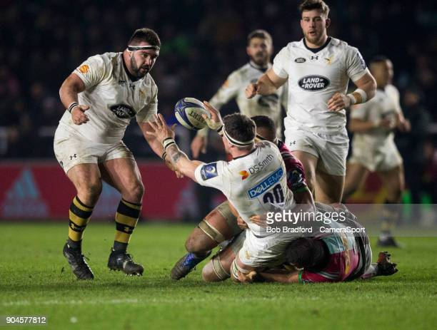 Wasps' Guy Thompson off loads in the tackle during the European Rugby Champions Cup match between Harlequins and Wasps at Twickenham Stoop on January...