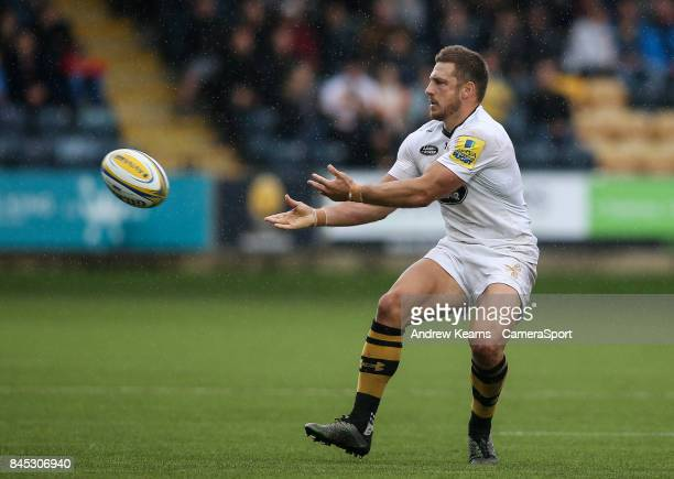 Wasps' Jimmy Gopperth offloads during the Aviva Premiership match between Worcester Warriors and Wasps at Sixways Stadium on September 10 2017 in...