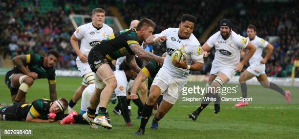 Wasps' Juan De Jongh breaks clear to score his sides fourth try during the Aviva Premiership match between Northampton Saints and Wasps at Franklin's...