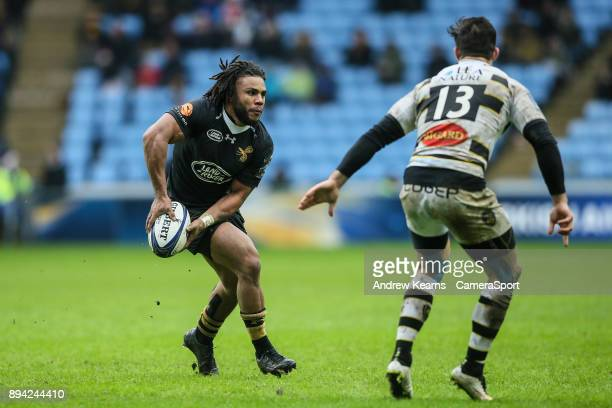 Wasps' Kyle Eastmond offloads during the European Rugby Champions Cup match between Wasps and La Rochelle at Ricoh Arena on December 17 2017 in...