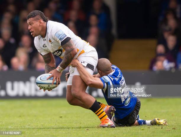 Wasps' Nathan Hughes is tackled by Bath Rugby's Jonathan Joseph during the Gallagher Premiership Rugby match between Bath Rugby and Wasps at...