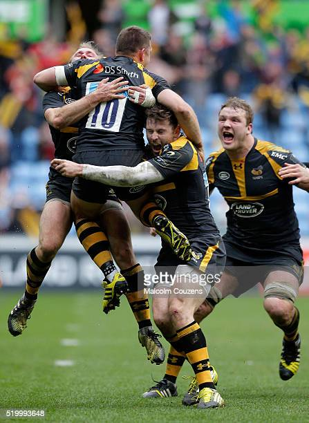 Wasps players celebrate the matchwinning conversion from Jimmy Gopperth during the European Rugby Champions Cup Quarter Final between Wasps and...