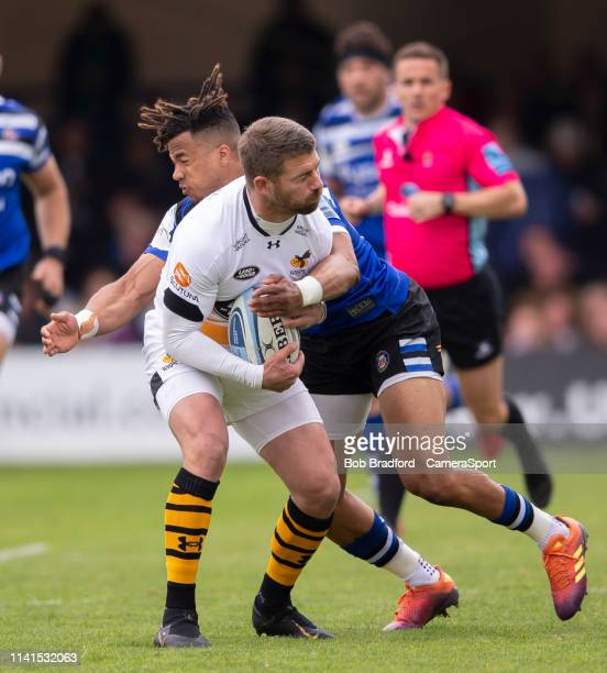 Wasps' Willie Le Roux is tackled by Bath Rugby's Anthony Watson during the Gallagher Premiership Rugby match between Bath Rugby and Wasps at...