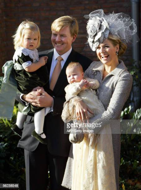 Crown prince WillemAlexander holds Princess Amalia while Princess Maxima holds their youngest daughter princess Alexia after the christening service...