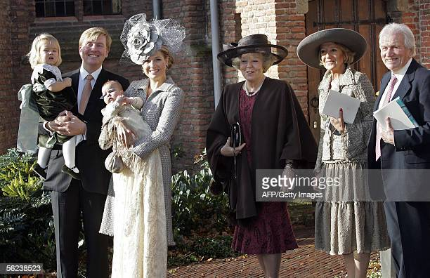 Dutch crown prince WillemAlexander and Princess Maxima carry their daughter Alexia into the Village Church for her christening From left to right...