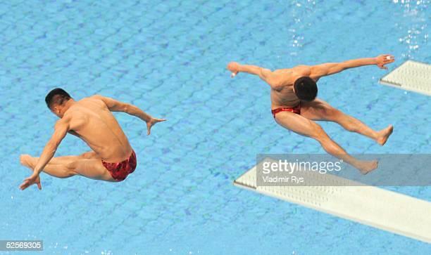 Wasserspringen Olympische Spiele Athen 2004 Athen Synchronspringen 3m / Maenner / Finale Bo PENG und Kenan WANG / CHN 160804