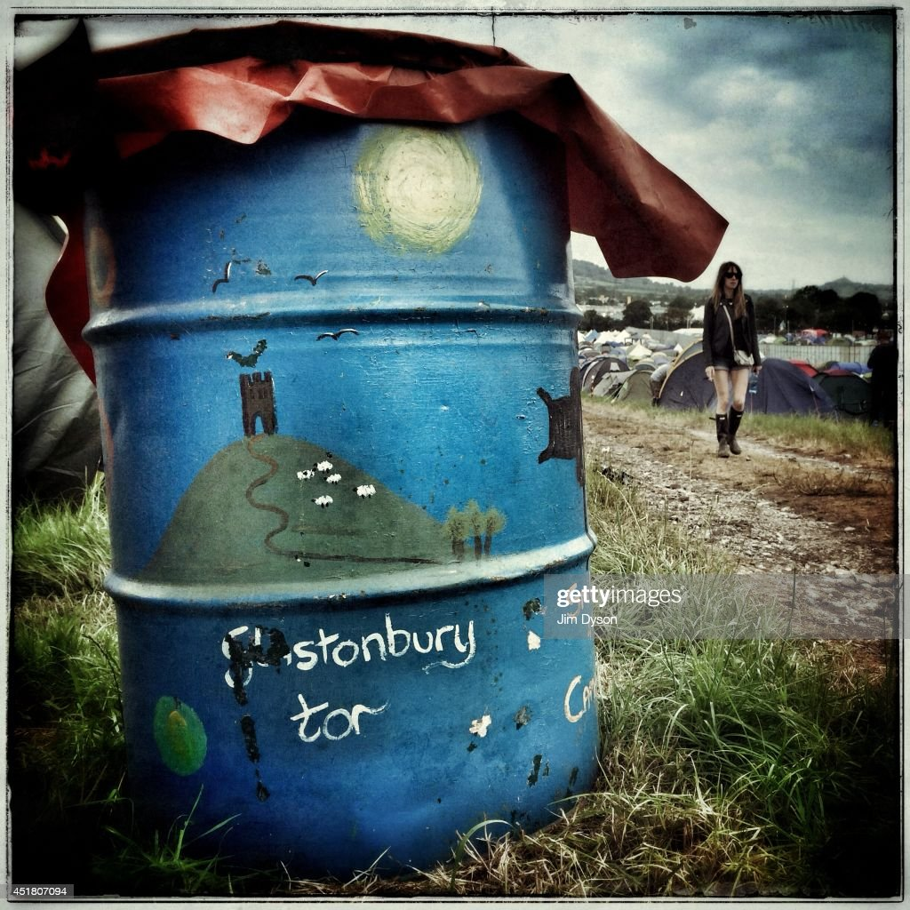 A waste bin painted with a representation of Glastonbury Tor is pictured in front of the real Glastonbury Tor in the distance during the Glastonbury Festival at Worthy Farm in Pilton on June 29, 2014 in Glastonbury, England.