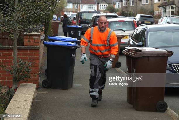 Waste bins are collected by refuse collectors on March 30 2020 in Northampton England The Coronavirus pandemic has spread to many countries across...