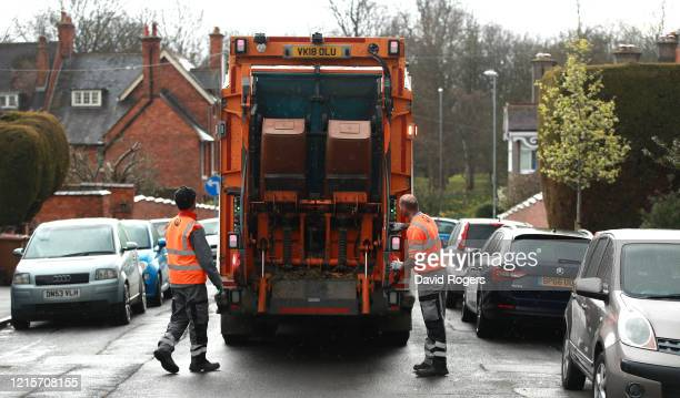 Waste bins are collected by refuse collectors on March 30, 2020 in Northampton, England. The Coronavirus pandemic has spread to many countries across...