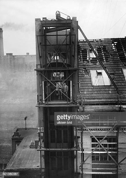 horses and loaded carts are let down from the top storey with a freight elevator undated probably around 1910