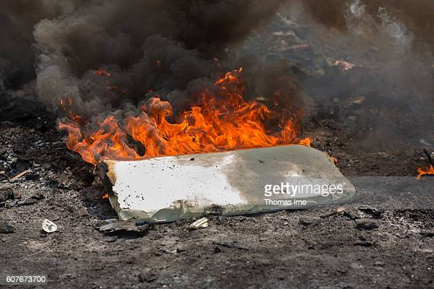 Waste incineration on the largest electronic scrap yard in Africa Disused equipment is burned to receive usable metal on September 09 2016 in Accra...
