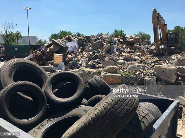 Waste is piled up at the District of Columbias Fort Totten Transfer Station in Washington DC on July 10 2018 Since China the top global importer of...