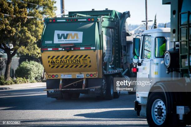 Waste Management Inc garbage collection trucks leave the company's Davis Street Recycling Transfer Station in San Leandro California US on Monday Feb...