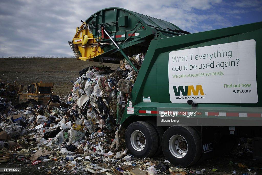 A Waste Management Inc. garbage truck dumps trash at the Waste ...