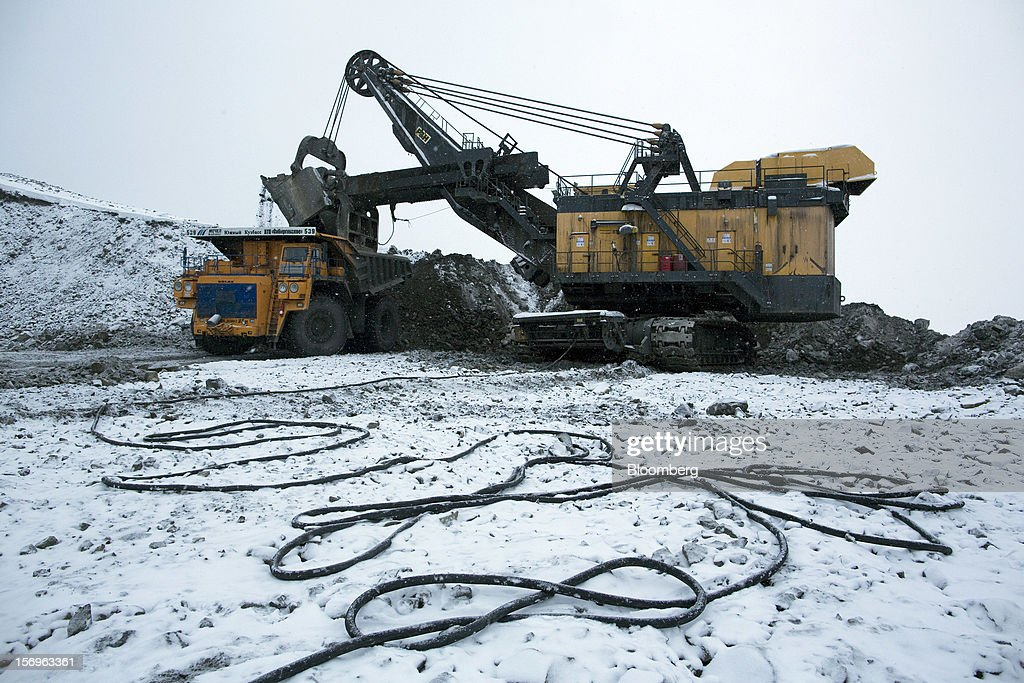 Waste material produced during the mining process is moved by an excavator into a Belaz truck at the Sibirginsky open pit coal mine, owned by OAO Mechel and operated by Southern Kuzbass Coal Co., near Myski, in Kemerovo region of Siberia, Russia, on Friday, Nov. 23, 2012. OAO Mechel is Russia's biggest maker of steelmaking coal. Photographer: Andrey Rudakov/Bloomberg via Getty Images