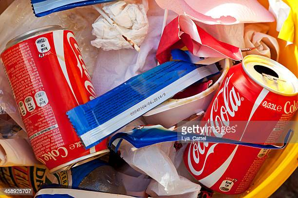 waste of cans, paper and snacks - editorial stock pictures, royalty-free photos & images