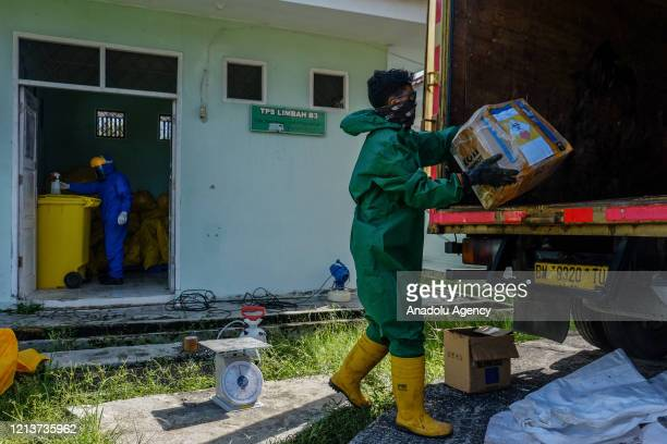 A waste officer transports hazardous medical waste from a referral hospital for COVID19 patients in Pekanbaru Riau Province Indonesia on May 19 2020...
