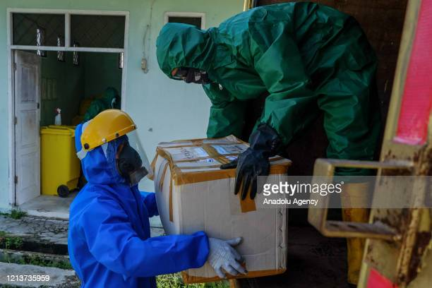 Waste officers transport hazardous medical waste from a referral hospital for COVID19 patients in Pekanbaru Riau Province Indonesia on May 19 2020...
