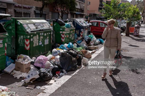 Waste overflows on the street in Cinecittà neighborhood on May 7 2017 in Rome Italy Rome has suffered in recent times from political failings to...