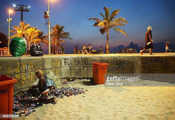 Waste picker Elenise sorts through cans collected at Arpoador Beach on February 13 2014 in Rio de Janeiro Brazil Waste pickers in Brazil perform a...