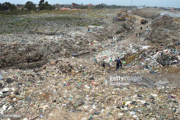Waste pickers are seen at Dandora dump site Nairobi generates an average of 3000 tons of solid waste every day from industries broken sewer lines use...