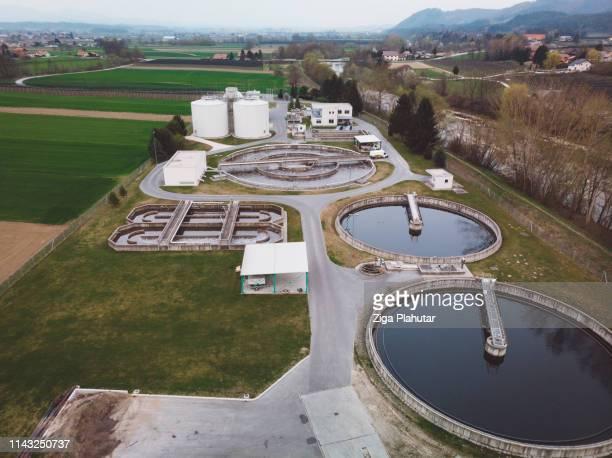 waste water treatment plant in the country side of slovenia - estação de tratamento de esgotos imagens e fotografias de stock