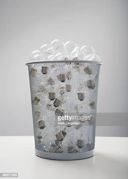 wastebasket full of old-fashioned light bulbs - incandescent bulb fotografías e imágenes de stock