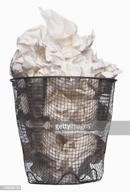 Wastepaper basket full of garbage