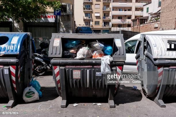 Wastes bins overflow on the street in Torpignattara neighborhood on May 1 2017 in Rome Italy