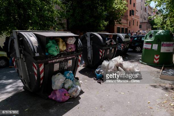 Wastes bins overflow on the street in Torpignattara neighborhood on May 1 2017 in Rome Italy Rome has suffered in recent times from political...