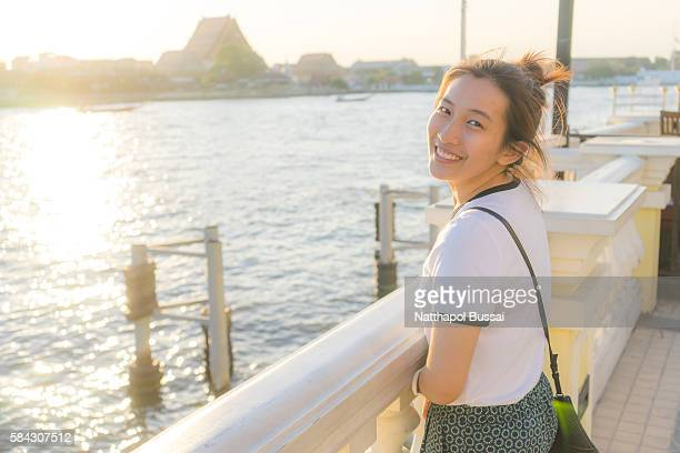 Wat Arun , Life near  river , Girl traveller is here , Bangkok , Thailand