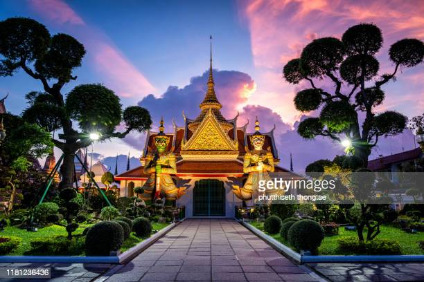 wat arun temple at sunset in bangkok thailand. wat arun is a buddhist temple in bangkok yai district of bangkok, thailand, wat arun is among the best known of thailand's landmarks - southeast stock pictures, royalty-free photos & images
