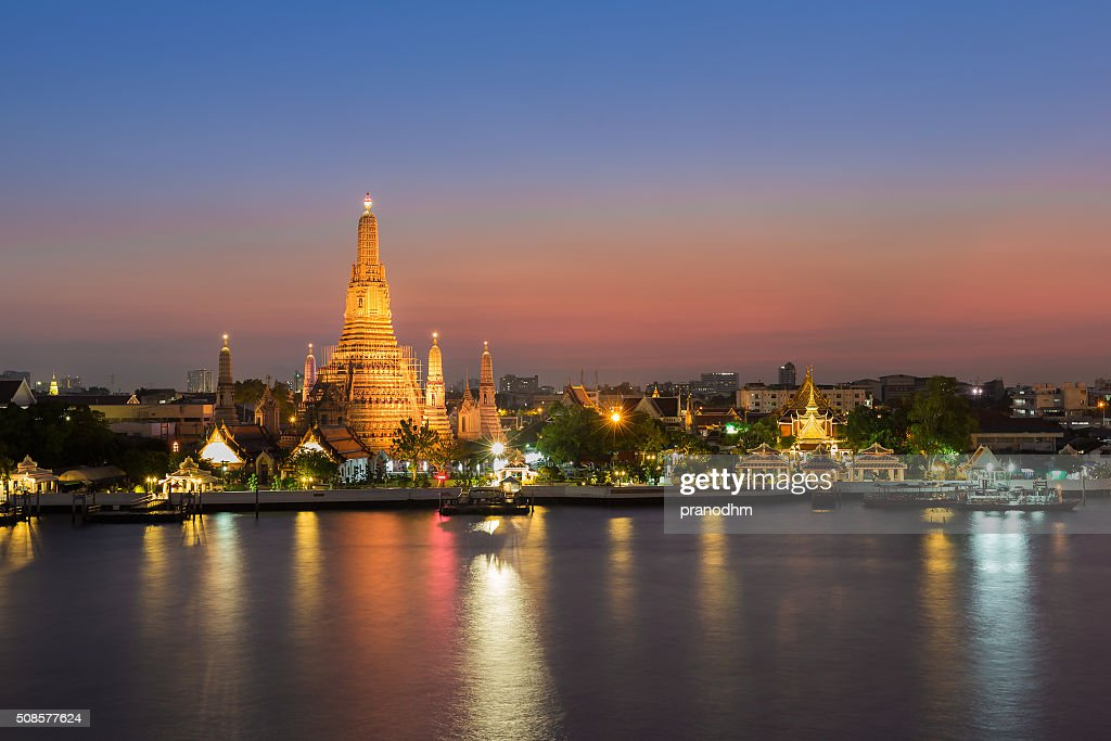 Wat Arun - the Temple of Dawn water front : Stock Photo