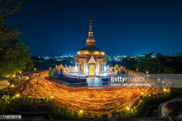wat charoen samanakit temple magha puja day - buddha's birthday stock pictures, royalty-free photos & images