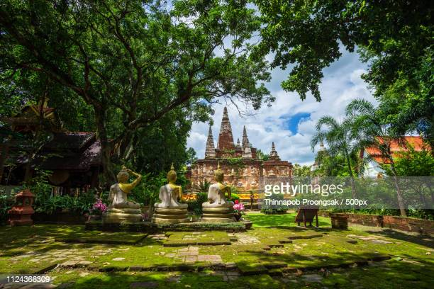 wat chet yot, seven pagoda temple it is a major tourist attraction in chiang mai, thailand.with... - wat stock pictures, royalty-free photos & images