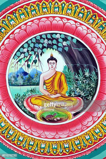 Wat Inpeng buddhist temple Painting depicting the life story of Shakyamuni Buddha Buddha sitting in the meditation pose Vientiane Laos