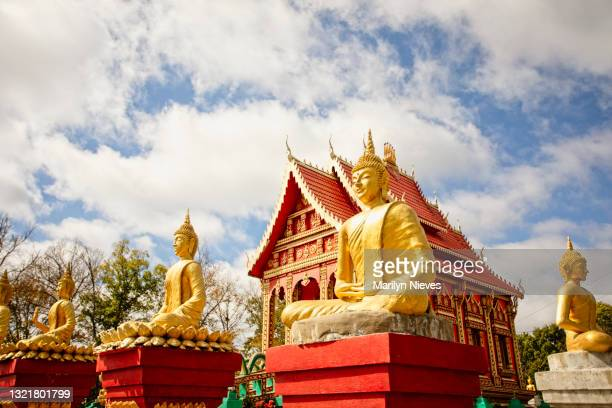 """wat lao buddha phothisaram buddhist temple - """"marilyn nieves"""" stock pictures, royalty-free photos & images"""