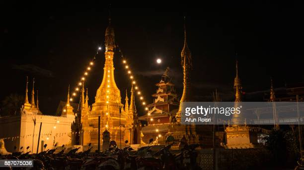 Wat Muay Tor is situated at the foot of Doi Kong Mu hill, there is a row of whitewashed chedis in front of the temple and Burmese-style Buddha statues in a hall. Mae hong Son Province, Thailand