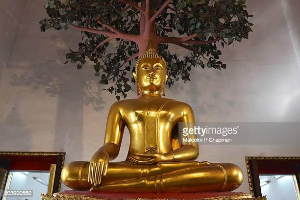 Wat Pho, Bangkok. Statue of Buddha achieving enlightenment.