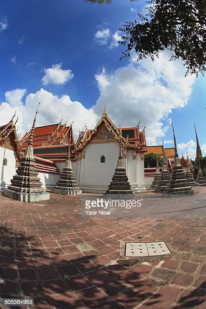 wat pho complex, bangkok - yasir nisar stock photos and pictures