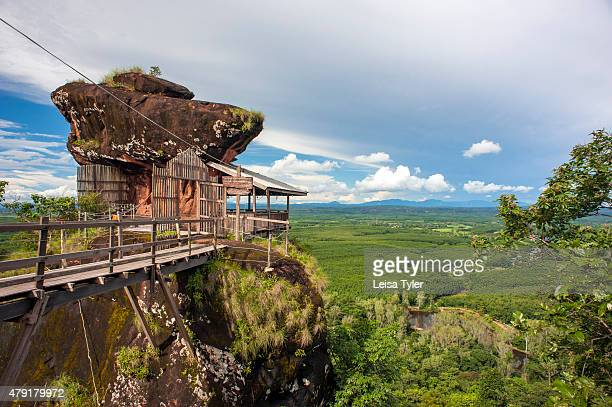 Wat Phu Tok a duel sandstone outcrop with multiple levels and dozens of meditation caves on the plains south of Nong Khai Around 50 monks inhabit the...