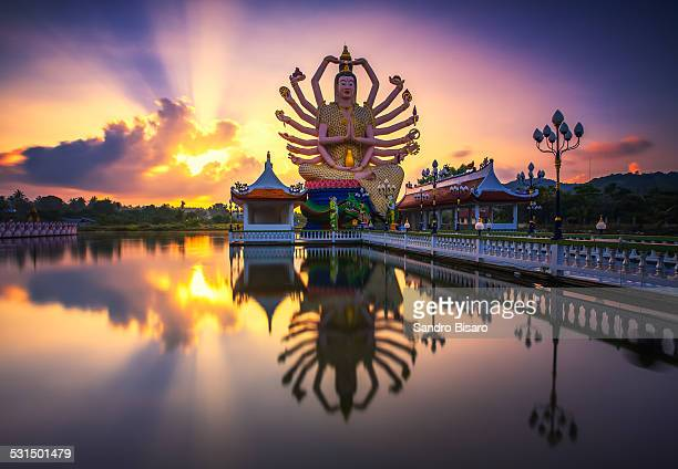 wat plai laem temple buddha statue at sunrise - ko samui stock photos and pictures