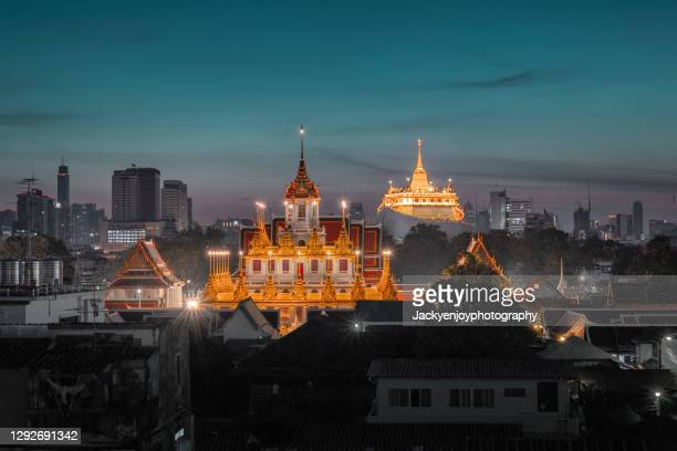 wat ratchanatdaram temple in bangkok, thailand. thai architecture: wat ratchanadda, loha prasat and traditional thai pavilion is among the best of thailand's landmarks. - palace stock pictures, royalty-free photos & images