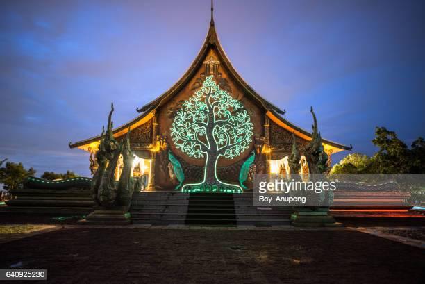 wat sirindhorn wararam (phu prao temple) at night. - theravada stock pictures, royalty-free photos & images