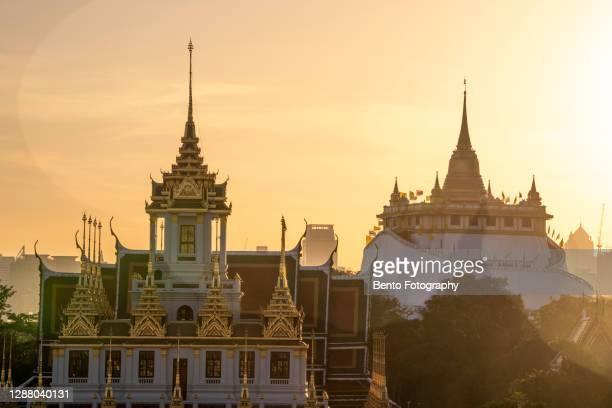 wat sraket rajavaravihara (wat phu khao thong) and wat ratchanadda (loha prasat) the famous temple grand palace with beautiful sunrise in bangkok thailand - royal tour stock pictures, royalty-free photos & images