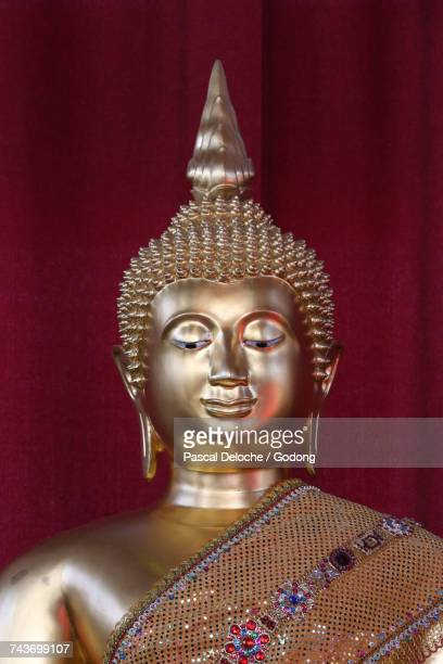 Wat Velouvanaram.  Golden Buddha statue.  France.